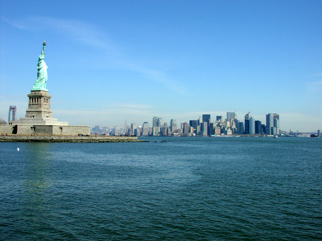 Liberty Island and the Statue of Liberty overlook Manhattan